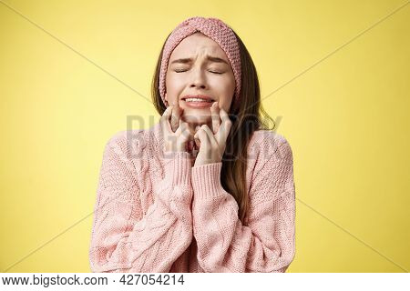 Worried, Nervous Tensed Young Cute Girl In Pink Glamour Headband, Sweater, Crossing Fingers For Good