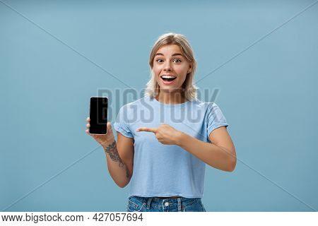Waist-up Shot Of Thrilled And Impressed Good-looking Female Student In Casual T-shirt Smiling Joyful