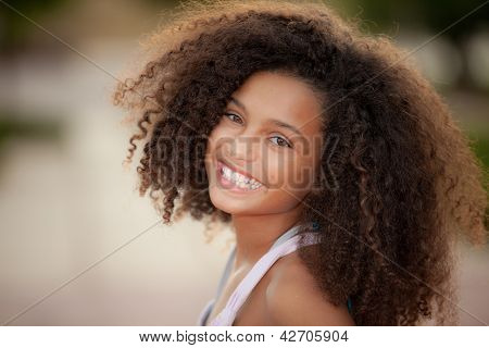 happy smiling african descent child with afro hair style
