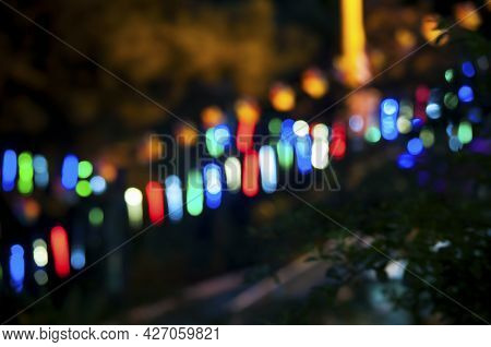 Multicolored Lighting Blurred Creating An Abstract Background In A Night View.