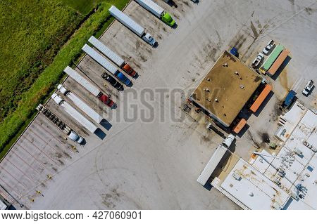 Aerial View Of Rest Area For Heavy Trucks With Restaurant And Large Car Park Near Highway