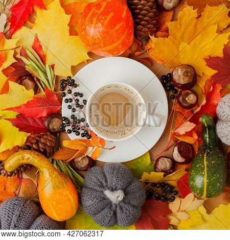 Autumn Flat Lay Composition With Dry Leaves Background And Coffee Latte Spicy Tea Cup. Creative Autu