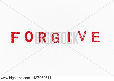 Red Color Ink Rubber Stamp In Word Forgive On White Paper Background