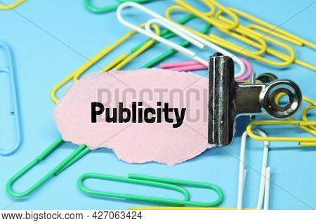 Click Paper, Torn Paper And The Word Publicity