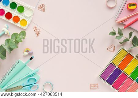 A Frame Of Pastel-colored School Supplies On A Pink Background, A Place For Text. Back To The School