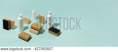 Set Of Neutral Beige Clean Sponges, Bottles With Liquid Soap Or Disinfect On Blue Background. Banner