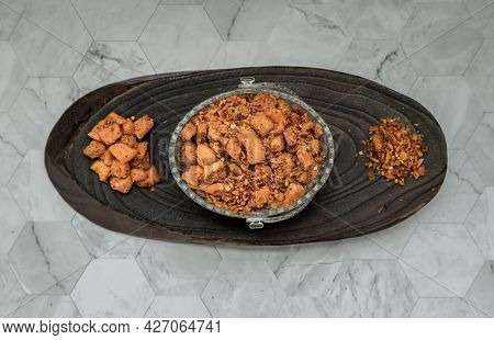 Pork Crackling Chili Paste (nam Prik Kag Moo) In Glass Bowl On Marble Table. Fried Chili And Fried P