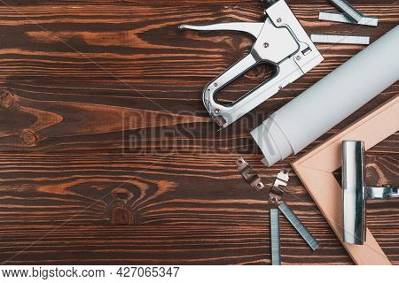 Devices For Stretching Canvas On A Wooden Frame. Stapler, Canvas Roll, Wood Frame And Tensioning Ton