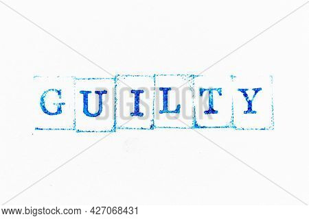 Blue Color Ink Rubber Stamp In Word Guilty On White Paper Background
