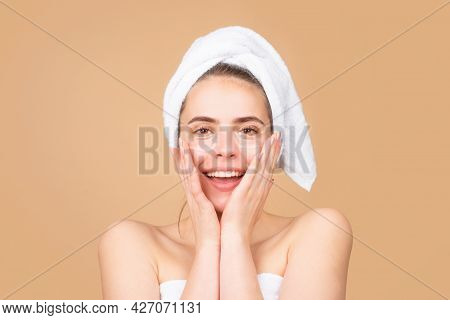 Happy Beautiful Girl With A Towel On Head, Facial Treatment, Cosmetology, Beauty And Spa.