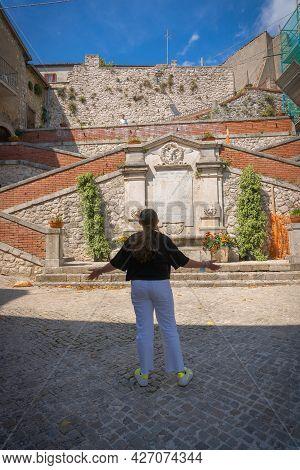 Castro Del Volsci, Italy - June 13, 2021, Girl From The Back On The Street Of Castro Del Volschi, Fr