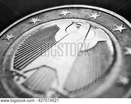 1 Euro Coin Issued In Germany Close-up. Obverse With The Federal Eagle. Dark Black And White Illustr
