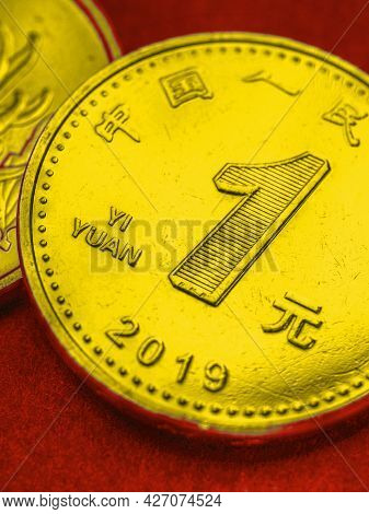 1 Chinese Yuan Coins Close-up. Bright Tinted Vertical Illustration In The Colors Of The National Fla