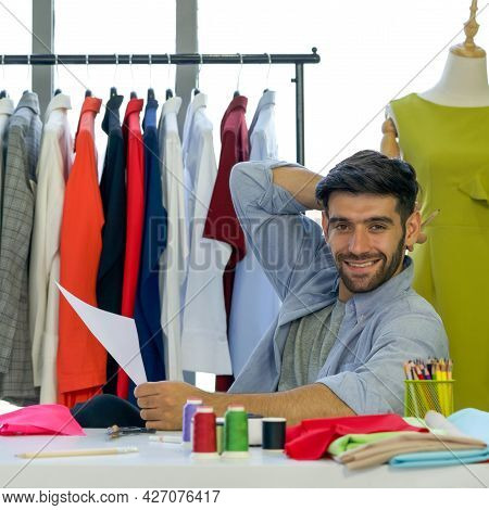 Fashion Designer Room, The Tailor Designs A New Collection Of Clothes In His Office. A Clothes Rack