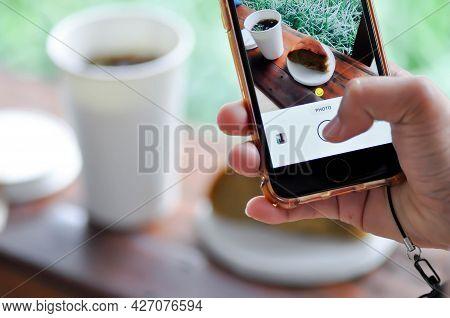Take A Photo Or Americano Coffee Or Iced Americano And Banana Cake