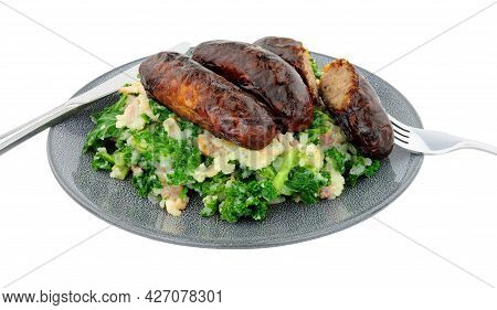 Traditional Irish Colcannon And Sausage Meal, Colcannon Is Made With Mashed Potato And Kale Or Cabba