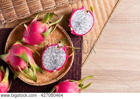 Dragon Fruit Or Pitaya In A Basket On Woden Background, Tropical Fruit, Table Top View