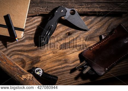 Edc Accessories And Empty Space In The Center. Pocket Knife And Copy Space. Edc Knife.