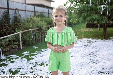 Happy Kid Enjoying Paper Show On Backyard During Outdoor Birthday Party, Social Distant Celebration