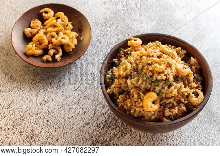 Shrimp Dish. Paella With Shrimps. Spanish Dish With Shrimps. Serving In Clay Bowls. View From Above.