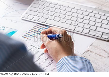 Investment Manager Analyze Financial Diagram. Close Up Woman Hand With Pen. Strategy Planning And Ba
