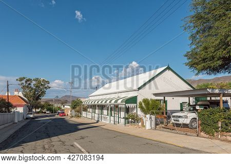 Prince Albert, South Africa - April 20, 2021: A Street Scene, With An Art Studio In A Historic House