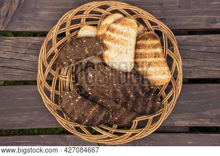 Wicker Platter With Slices Of Grilled Bread