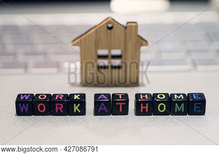 Blocks With Alphabet Letter Work At Home And Notebook Computer On Table With. Stay At Home For Worki