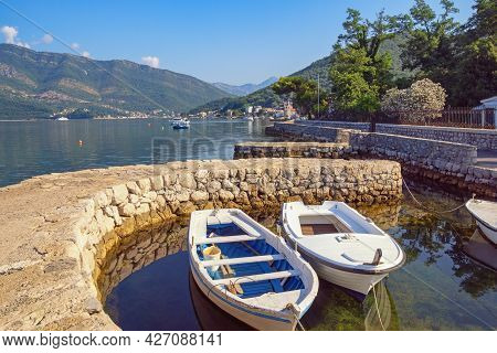 Beautiful Summer Mediterranean Landscape With Fishing Boats In Small Harbor. Montenegro, Adriatic Se