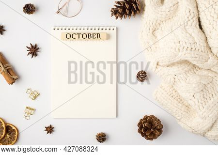 Top View Photo Of White Scarf Notebook With Inscription October Pine Cones Dried Lemon Slices Cinnam