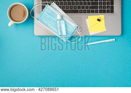 Top View Photo Of Transparent Sanitizer Bottle Two Medical Facemasks Pen Binder Clip Sticker Notes P