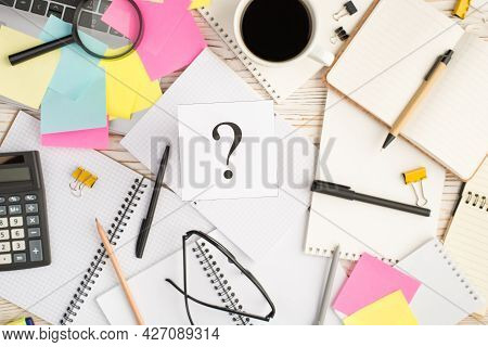 Top View Photo Of Multicolor Sticker Notes With Interrogation Mark Laptop Cup Of Coffee Binder Clips