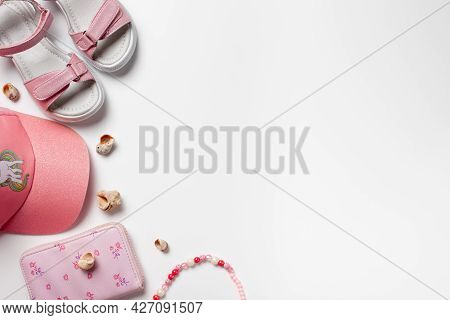 Flat Lay With Summer Accessories. Girls Accessories, Pink Sandals And Cap On The White Isolated Back