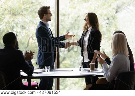 Business Team Leader Congratulating Employee On Hiring, Promotion