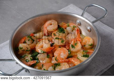 Shrimp Scampi With Garlic And Butter Sauce Sprinkled With Parsley, On A Skillet. Keto Diet Dish