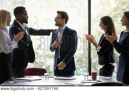 Grateful Diverse Team Expressing Recognition, Appreciation, Acknowledge To Leader