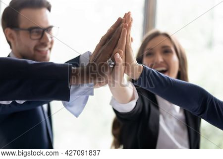 Excited Office Employees Giving Group High Five