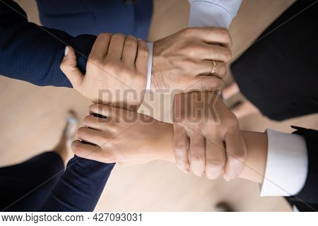 United Business Team Holding Wrists And Making Unbreakable Hand Square