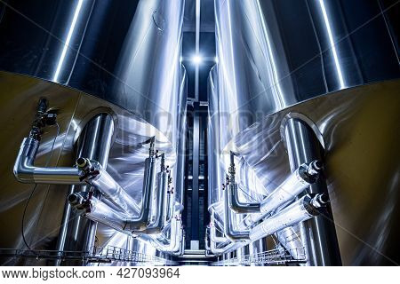 Rows Of Steel Tanks For Beer Fermentation And Maturation In A Craft Brewery