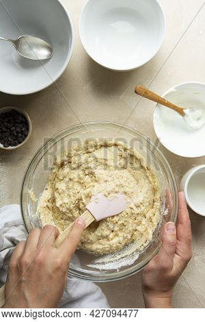 Female Hands Mixing Raw Dough, Cooking Bundt Cake In Glass Bowl Top View, Step By Step Recipe.
