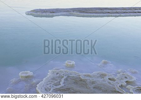 Sunset At The Dead Sea. Salt Formations. Mountain Range
