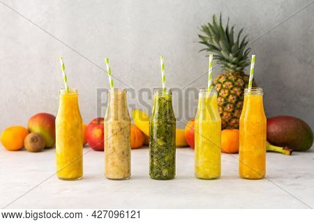 Fruit Smoothies In Jars With Straws