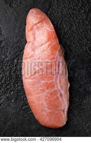 Raw Cod Fish Roe Protein Delicacy On Black Stone Background