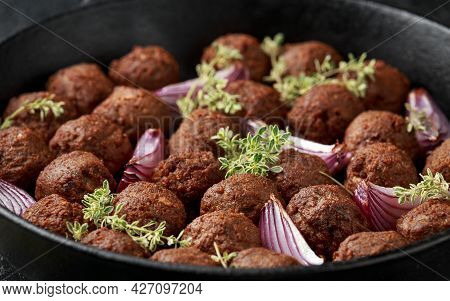Vegetarian Vegan Meatballs With Thyme And Onion In Cast Iron Skillet Frying Pan