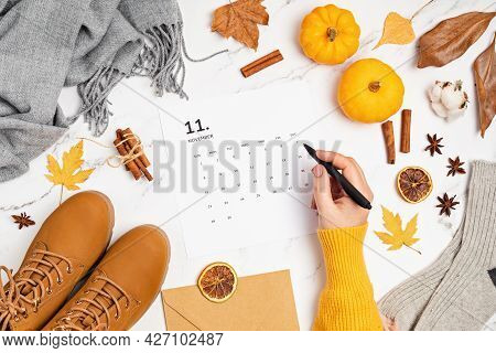 Flat Lay With Calendar For November With Woman Fashion Fall Accessories