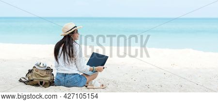 Lifestyle Freelance Woman Using Laptop Working And Relax On The Beach. Asian People Success And Tog