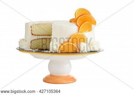 Isolated Vanilla Cake With Orange Slices On Cake Stand