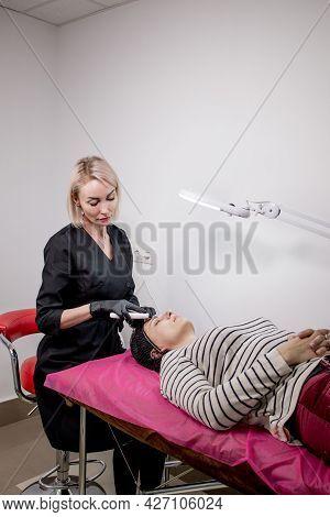 Young Woman Receiving Ultrasound Cavitation Facial Peeling Cleansing. Cosmetology Facial Skin Care T