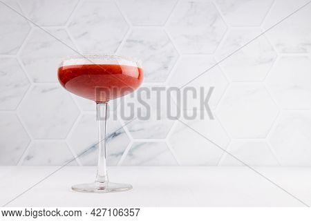 Fresh Strawberry Margarita Cocktail In High Glass Goblet With Sugar Rim In Soft Light White Kithchen