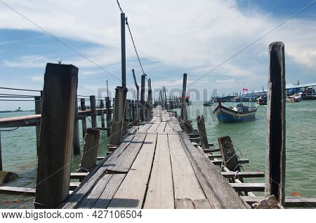 A Wooden Pier Near The Entrance Of The Penang National Park On A Sunny Summer Day In Malaysia.